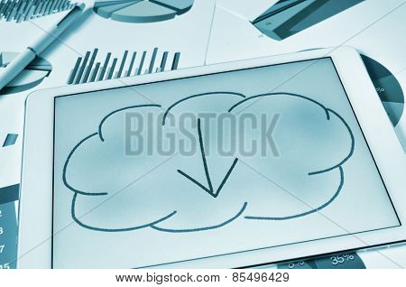 a drawing of a cloud with an arrow inside on the screen of a tablet, depicting the concept of download from the cloud storage