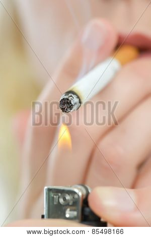 Blond woman smoking