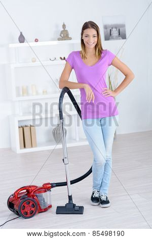Woman stood with a vacuum cleaner
