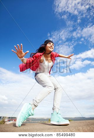 sport, dancing and urban culture concept - beautiful dancing girl in movement