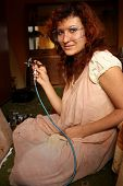 picture of drow  - A young woman painting with airbrush equipment - JPG