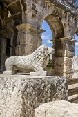 stock photo of wrecking  - Antique wrecked lion statue in Pula - JPG