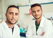 foto of scientist  - Group of scientists conducting research in a lab environment - JPG