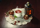 picture of teapot  - Cup of tea and teapot on dark background - JPG