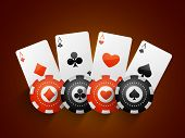 foto of poker machine  - Ace playing cards with Casino chips on brown background - JPG