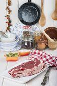 stock photo of porterhouse steak  - Raw steaks on the kitchen table ready to cook - JPG