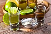 foto of crystal salt  - gold tequila with salt and lime on old wooden table - JPG