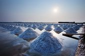 stock photo of salt mine  - Heap of sea salt in original salt produce farm made from natural ocean salty water preparing for last process before sent it to industry consumer - JPG