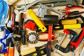 foto of tool  - Working tools. Many working tools on a wooden background.