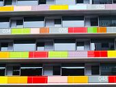 pic of colorful building  - Modern residential building with terraces with colored glass - JPG