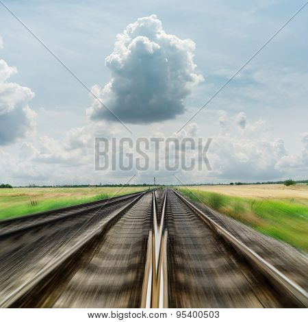 railroad to horizon in dramatic clouds. motion effect
