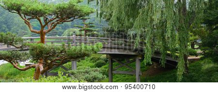 Wooden Bridge crossing over a river to a Japanese Garden