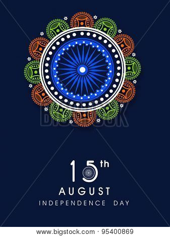 Beautiful greeting card with floral design decorated Ashoka Wheel on blue background for 15th August, Indian Independence Day celebration.