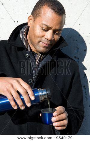 Man Pouring Tea