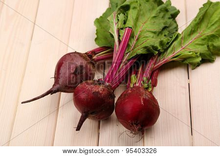 Young beets on wooden table