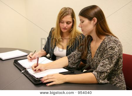 Business Women Taking Notes