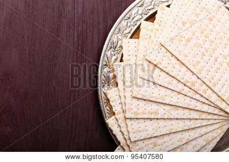 Matzo for Passover on metal tray on table close up