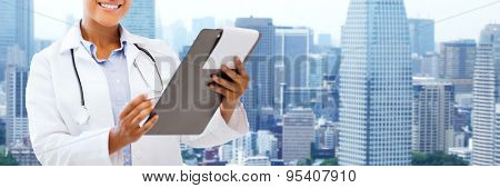 health care, people and medical concept - happy african female doctor with clipboard over city background