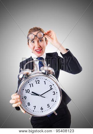 Nerd businesswoman with giant alarm clock