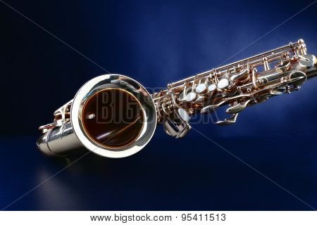 Golden saxophone on dark background