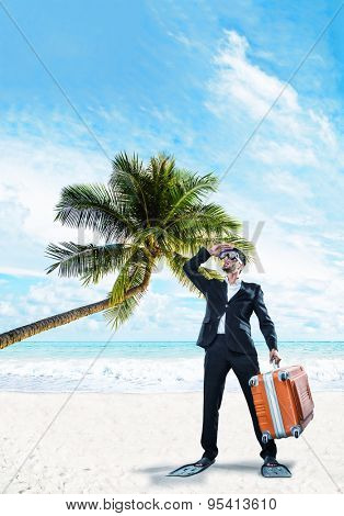 Man in suit holsing a suitcase at the tropical beach