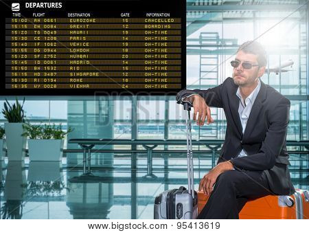 Business man at the airport - The board read Eurozone cancelled Gexit Boarding