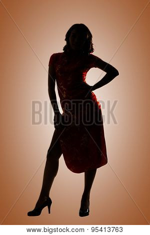 Silhouette of Chinese woman dress traditional cheongsam at New Year, studio shot isolated.