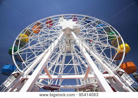 Colorful ferris wheel over blue sky