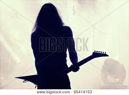 Guitarist silhouette- retro style photo