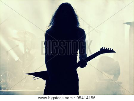 Guitarist silhouette- retro style photo