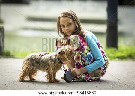 Cute little girl on a walk with her doggy.