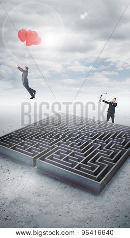 Businessman shooting a bow and arrow against cloudy sky over maze