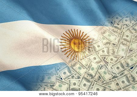 Pile of dollars against digitally generated argentinian national flag