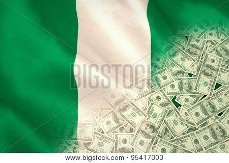 Pile of dollars against digitally generated nigerian national flag