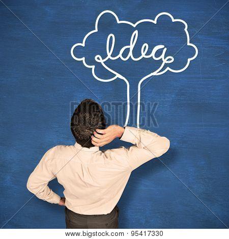 Thinking businessman scratching head against blue chalkboard