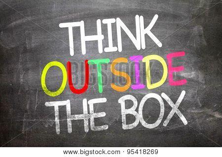 Think Outside the Box written on a chalkboard