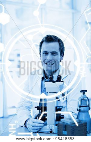 Science graphic against male scientist looking at a slide under a microscope