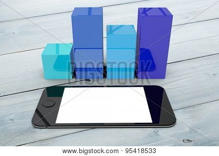 Smartphone with graphs against bleached wooden planks background