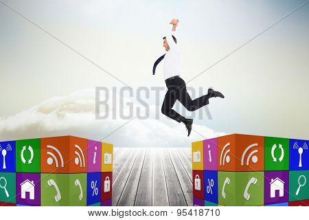 Jumping businessman against wooden planks leading to bright sky