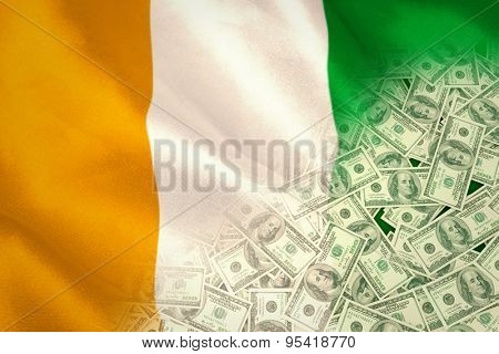 Pile of dollars against ivory coast national flag