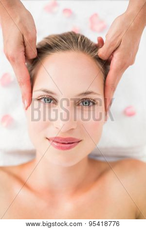 pretty blonde receiving head massage at the spa