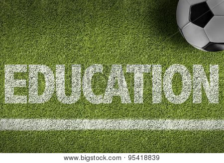 Soccer field with the text: Education