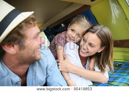 Portrait of cheerful family having fun in camper