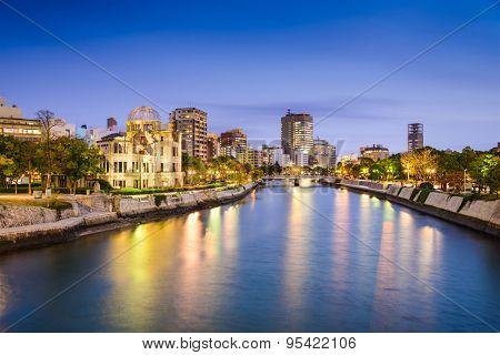 Hiroshima, Japan city skylilne on the Otogawa River near the Atomic Dome memorial ruins.