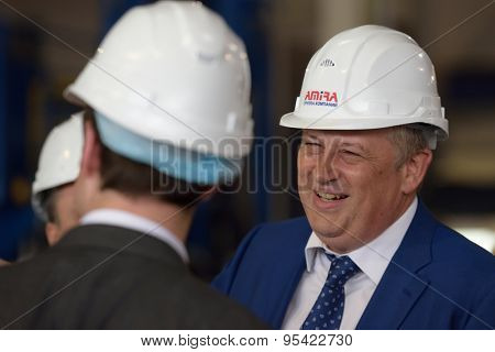 ST. PETERSBURG, RUSSIA - JUNE 30, 2015: Governor of Leningrad oblast Alexander Drozdenko in the Megapolis plant owned by Amira Group. It's Russia's largest plant producing the lighting poles