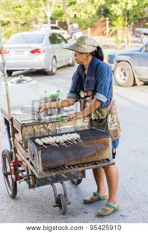 Bangkok, Thailand - June 6, 2015: Street food vendor cart selling grilled pork ball.