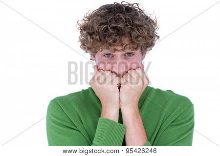 Anxious casual man looking at camera on white background