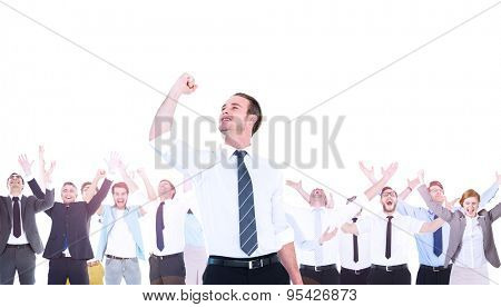 Composite image of businessman cheering with clenched fist cheering