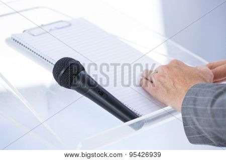 Businessman taking notes at conference in the meeting room