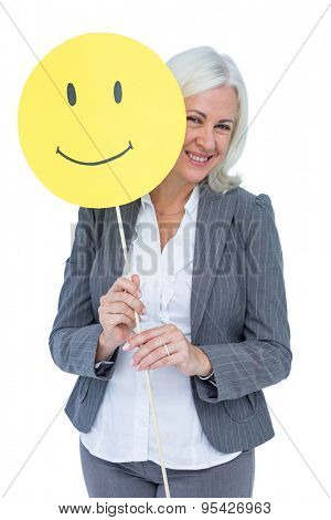 Businesswoman holding happy smiley face on white background